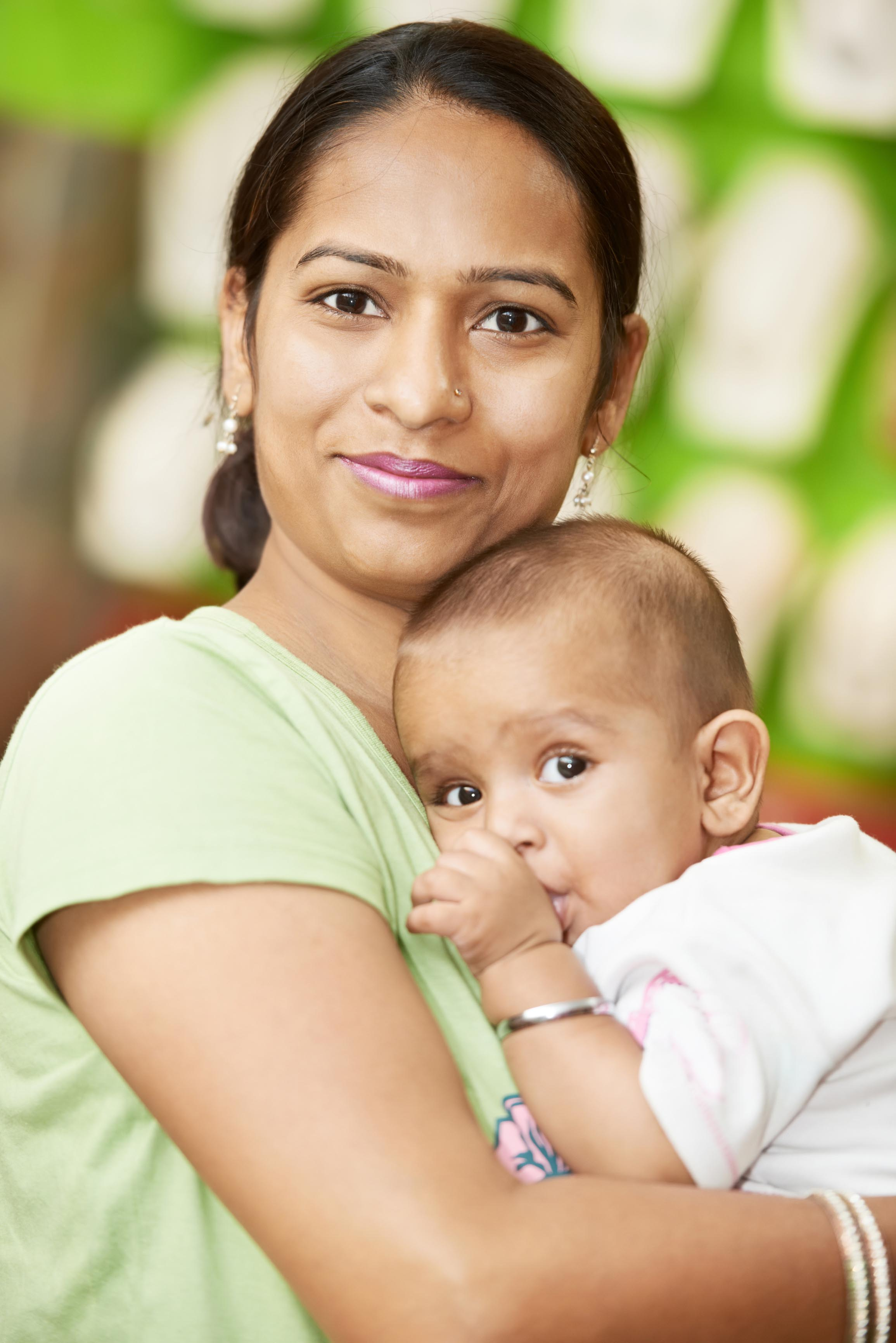 Indian woman with baby - Dreamstime Stock Image